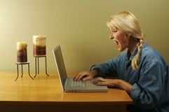 Woman Using Laptop Series royalty free stock photography