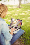 Woman using laptop while sitting in park Royalty Free Stock Photos