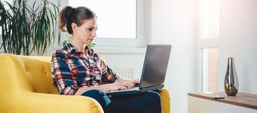 Woman using laptop royalty free stock images