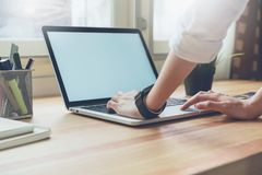 Woman using laptop on table in office room, for graphics display montage. Stock Photography