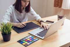 Woman using laptop on table in office room, for graphics display montage. royalty free stock photo