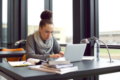 Woman using laptop for taking notes to study stock photography