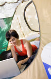 Woman using laptop in tent Stock Photography