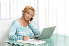 Woman using laptop to work from home Stock Photo