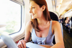 Woman Using Laptop On Train Royalty Free Stock Images