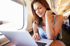 Woman Using Laptop On Train Stock Images