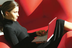 Woman using laptop tyu Stock Photo