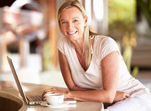 Woman using laptop on vacation Stock Image