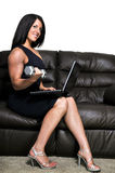 Woman Using Laptop While Working Out Royalty Free Stock Images