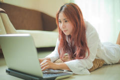 Woman using a laptop Royalty Free Stock Image