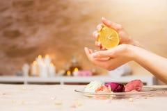 Woman using lemon in manicure procedure Stock Photos