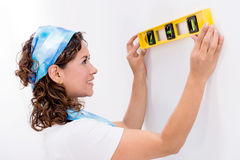 Woman using a level tool Royalty Free Stock Photo