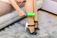 Woman using lint roller Stock Photography