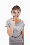 Woman using magnifier Royalty Free Stock Image