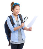 Woman using magnifying glass for the map Royalty Free Stock Photography