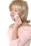 Woman using makeup applicator Royalty Free Stock Photos