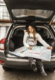 Woman Using Map on Gray Car Compartment Royalty Free Stock Photography