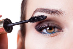 Woman using mascara Royalty Free Stock Image