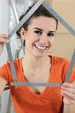 Woman using measuring device Royalty Free Stock Photos