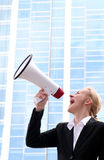 Woman using megaphone Royalty Free Stock Photography