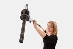 Woman Using Microphone Boom Royalty Free Stock Photo