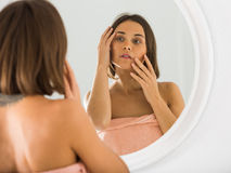 Woman using mirror Royalty Free Stock Image
