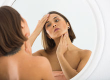 Woman using mirror Stock Photography