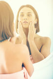 Woman using mirror Royalty Free Stock Images