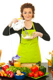 Woman using mixer Stock Photography