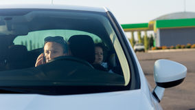 Woman using a mobile in a car Royalty Free Stock Image