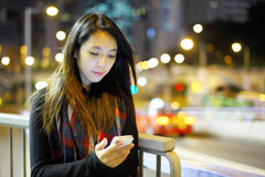 Woman using mobile at night Stock Photography