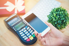 Woman using mobile payment Stock Photo