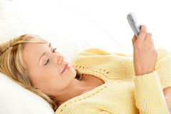 Woman using mobile phone Stock Photo