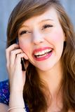 Woman using mobile phone Royalty Free Stock Photography