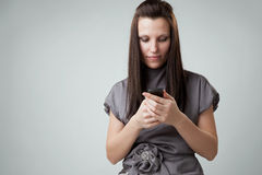 Woman using a mobile phone Royalty Free Stock Image