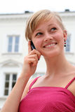 Woman using a mobile phone Stock Images