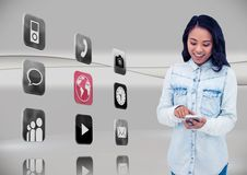 Woman using mobile phone with application icons on grey background Stock Photo