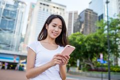 Woman using mobile phone Stock Images
