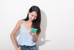 Woman using mobile phone. Asian young woman Royalty Free Stock Images