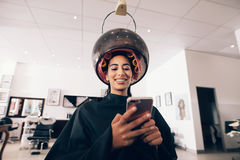 Free Woman Using Mobile Phone At The Beauty Spa Stock Image - 97786751