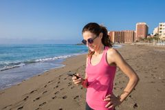 Woman using mobile phone at beach in Benalmadena Stock Photography