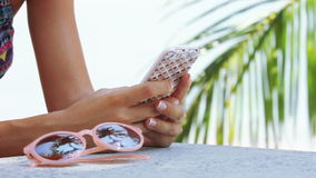 Woman Using Mobile Phone on the Beach. Sea and palm leaves Background. Close up. HD, 1920x1080 stock footage