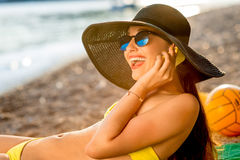 Woman using mobile phone on the beach Royalty Free Stock Images