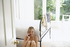 Woman Using Mobile Phone By Bed Royalty Free Stock Images