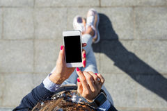 Woman using mobile phone. While being outdoors stock photography