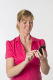Woman using a mobile phone Royalty Free Stock Photo