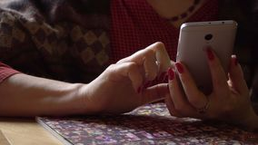 Woman using the mobile phone in cafe. On this video you see as the woman of the business woman sits in cafe. Hours of the woman in phone in a lunch break. The stock video