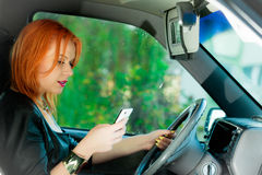 Woman using mobile phone in the car. Stock Photo