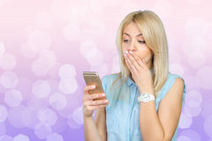 Woman using mobile phone Royalty Free Stock Photos
