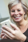 A woman using a mobile phone. Royalty Free Stock Photos